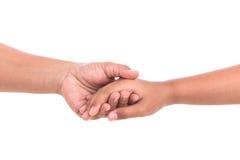 Mère tenant sa main de fille Concept d'aide ou de soutien isola Photo stock