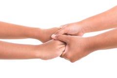 Mère tenant sa main de fille Concept d'aide ou de soutien isola Image libre de droits