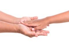 Mère tenant sa main de fille Concept d'aide ou de soutien isola Photographie stock