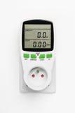 Mètre de consommation de courant électrique sur le mur blanc Photos stock