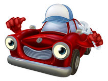 Mécanicien de voiture avec la clé Photographie stock libre de droits