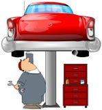 Mécanicien et un véhicule rouge Photographie stock libre de droits