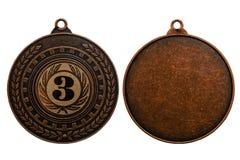 Médaille de bronze d'isolement sur le fond blanc Image stock