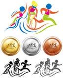 Médailles d'icône et de sport de triathlon Photographie stock