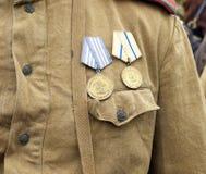 Médailles sur la poitrine Photographie stock libre de droits
