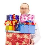 Médecin avec beaucoup de cadeaux Images libres de droits