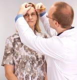 Médecin et patient Photographie stock