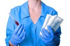 Médecine et argent Image stock