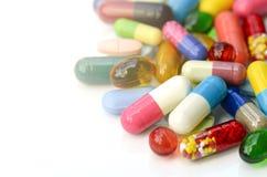 Médicaments oraux sur le fond blanc photographie stock