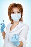 Médico com seringa Fotografia de Stock
