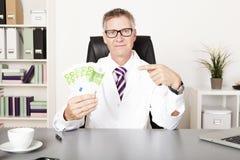 Médico Pointing Money en la otra mano imágenes de archivo libres de regalías
