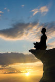 Méditation de coucher du soleil Images stock