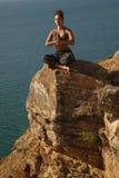 Méditation près de l'eau Photographie stock libre de droits