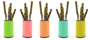 Mélangez le paquet de l'organisateur de plastique coloré de boîte de couteaux de cuisine d'isolement sur le blanc Photographie stock libre de droits