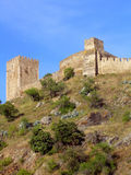 Mértola Castle. Low point view of an ancient castle in the city of Mértola, that is located on the Alentejo, Portugal Royalty Free Stock Image