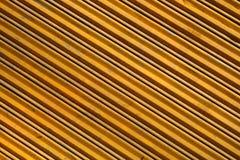 Métal jaune rayé Photos libres de droits