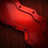Métal pollished par rouge sur le bachkround en bois Photographie stock libre de droits
