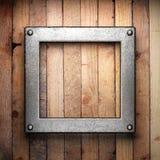 Métal sur le fond en bois illustration stock