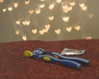 Métaphore bleue de visuel de brosse à dents de couples gais de LGBT Photo libre de droits