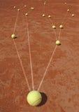 Métaphore d'affaires avec des billes de tennis Photos libres de droits