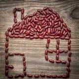 métaphore de maison d'eco des haricots rouges Image libre de droits