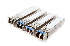 Módulos óticos do sfp do gigabit para o interruptor de rede no fundo branco fotos de stock royalty free