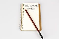 Mój opowieści książka na bielu z brown ołówkiem Obrazy Royalty Free