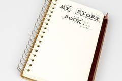 Mój opowieści książka na bielu z brown ołówkiem Fotografia Stock