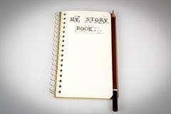 Mój opowieści książka na bielu z brown ołówkiem Zdjęcia Royalty Free