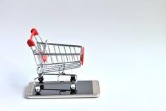 Móvil con el carro de la compra Imagen de archivo libre de regalías