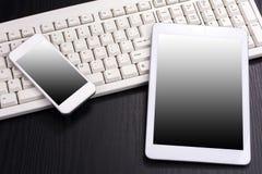 Móvil y teclado Imagen de archivo libre de regalías