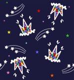 Mönstra carons och stjärnor på en blå bakgrund Arkivfoton