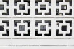 mönstrad den fyrkantiga stenväggen Fotografering för Bildbyråer