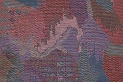 Mönstrat stoppningtyg för textur tonar abstrakt begrepp av mörka lilor Arkivfoto