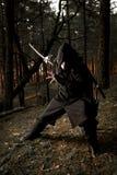 Mördare i den djupa skogen Royaltyfri Bild