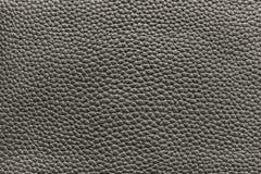 Mörk beige textur av lädermaterial Royaltyfri Bild