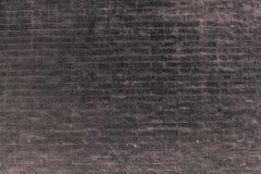 Mörk fasastilvägg för bakgrund royaltyfri bild