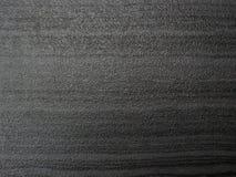 Mörk grå färgsvart kritiserar bakgrund eller textur royaltyfri bild