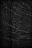 Mörk grå färgsvart kritiserar bakgrund eller textur arkivbild