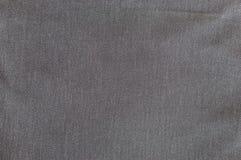Mörk grå jeanstextur Arkivfoton