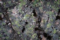 Mörk granitstentextur Arkivfoton