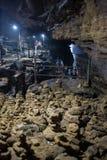 Mörk grotta med mankonturn Royaltyfri Foto