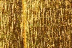 Mörk guld- folie för skinande gult blad arkivfoto