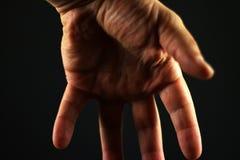 mörk hand Arkivbild