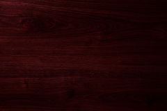 Mörk körsbärsröd wood textur Arkivfoton