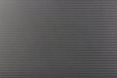 Mörk plast- textur med symmetriska konturer Arkivfoto