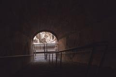Mörk tunnel och port Arkivbild