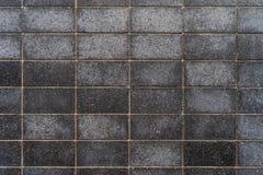 Mörka gråa granittegelplattor med fina modeller - högkvalitativ textur/bakgrund royaltyfri bild