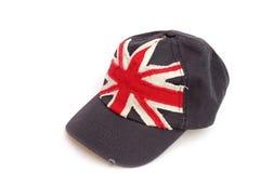 Mörker - blå baseballmössa med den brittiska flaggan Arkivfoton