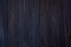 Mörker - blå träbakgrund Arkivbild